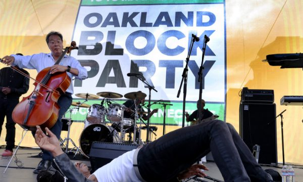 Yo-Yo Ma, left, and dancer Michael Boyd Carter, of Turfin 247, perform during Oakland Block Party with Yo-Yo MA and XQ free event on Washington Street in Oakland, Calif., on Saturday, Sept. 29, 2018. The block party celebrated the city's rich cultural heritage and included performances by local bands Sol Development, Ajai Kasim, Nick Reeves, Jax The Band and 24/7 Turfin Dancers. Also, artists worked on installations that will be donated to public schools. (Ray Chavez/Bay Area News Group)