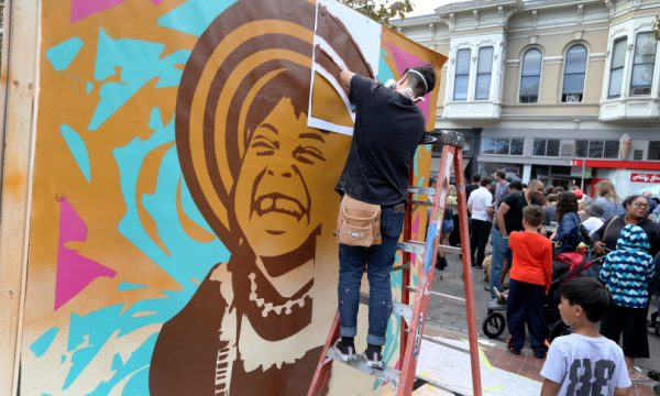 "Artist Jessica Sabogal, of San Francisco, paints an indigenous Colombian girl titled ""Women Are Prefect"" during the Oakland Block Party with Yo-Yo MA and XQ free event on Washington Street in Oakland, Calif., on Saturday, Sept. 29, 2018. The block party celebrated the city's rich cultural heritage and included performances by local bands Sol Development, Ajai Kasim, Nick Reeves, Jax The Band and 24/7 Turfin Dancers. Also, artists worked on installations that will be donated to public schools. (Ray Chavez/Bay Area News Group)"