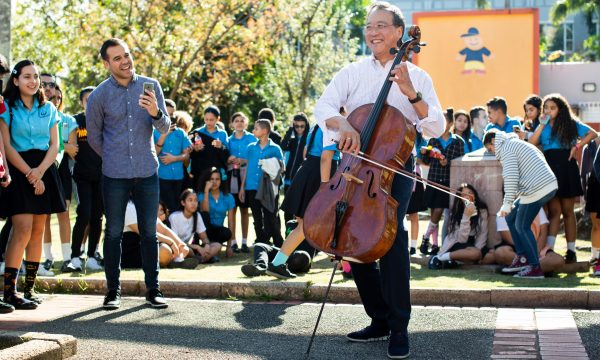 Yo-Yo Ma plays for students in a plaza near the Escuela Libre de Música in San Juan, P.R., on March 21, 2019. (Photo by Erika P. Rodriguez)